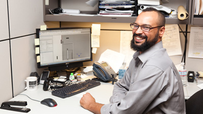 A member of the mobility design team smiling while working